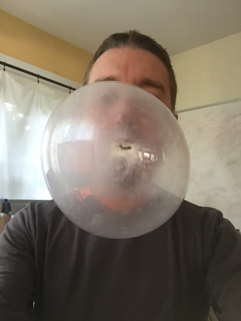 A close up shot of a large bubble gum bubble