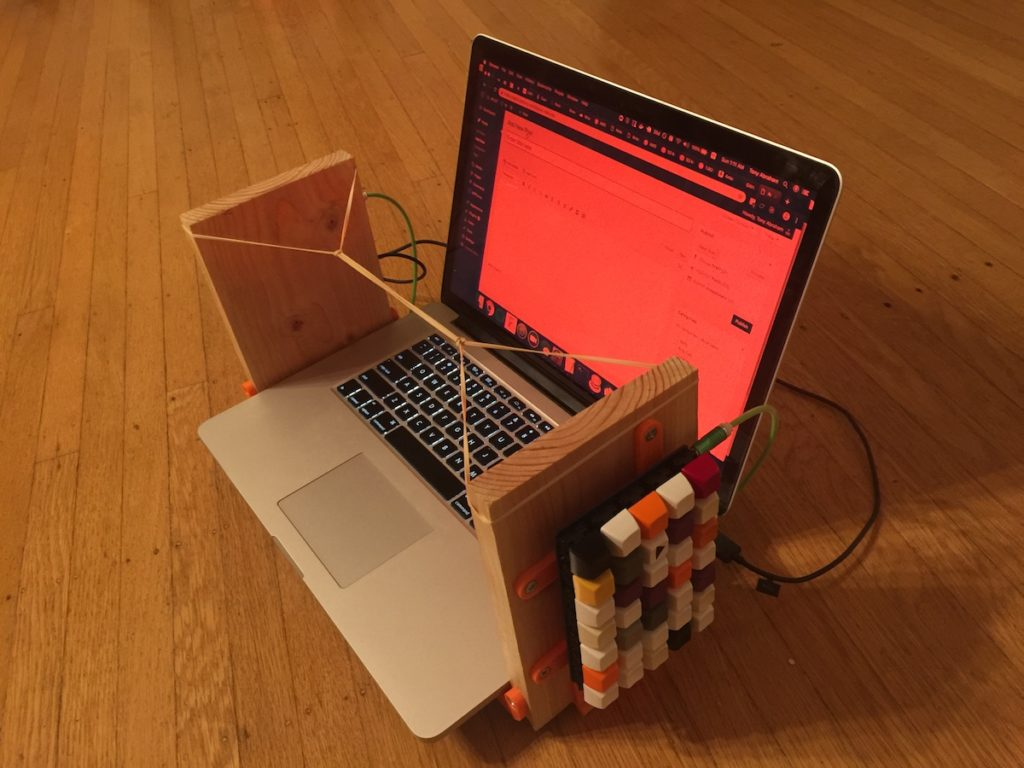 A laptop with a homemade vertical keyboard.