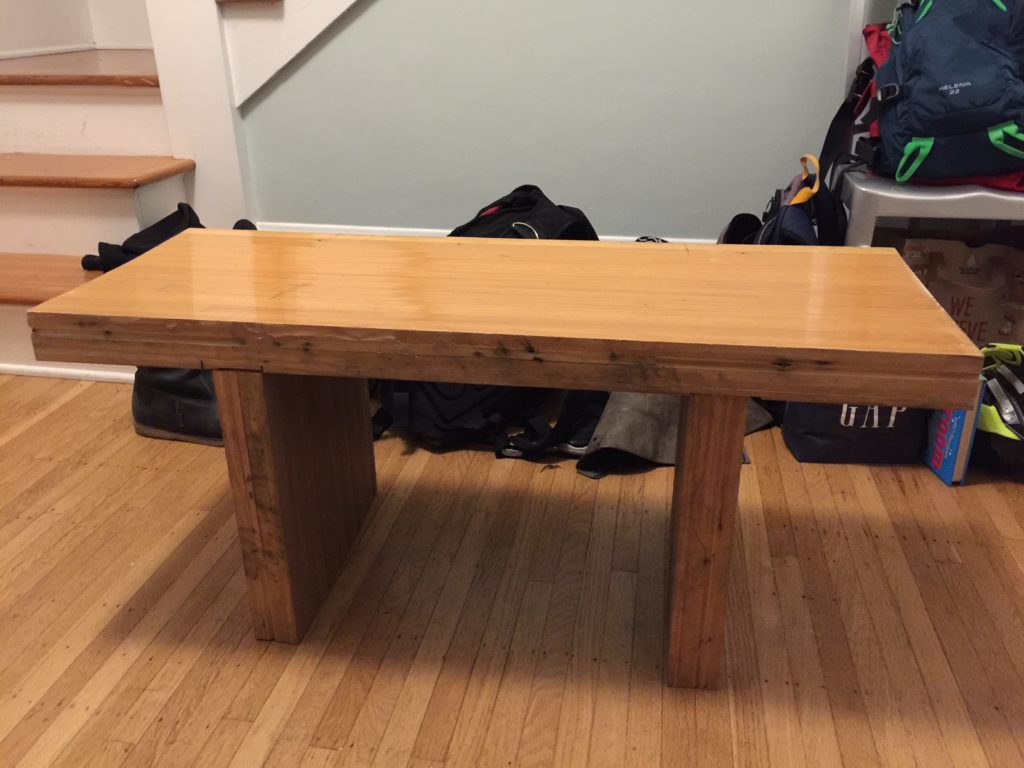 A wooden bench made from bowling alley floor