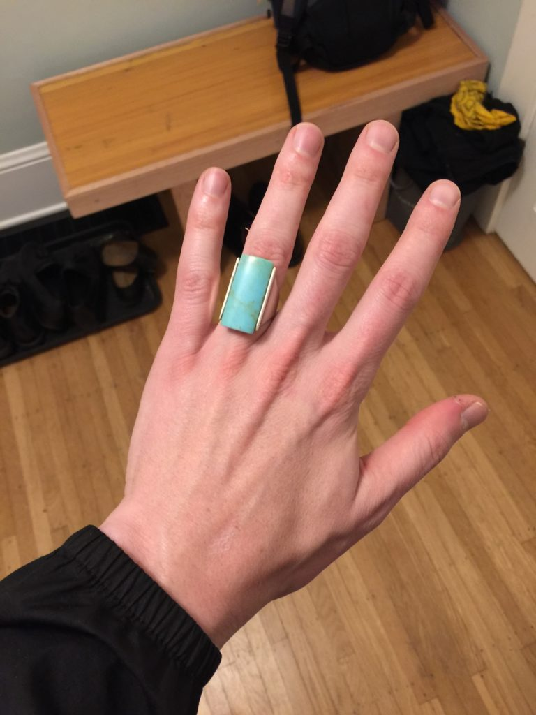 A clunky turquoise ring on my finger